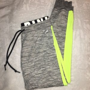 VS PINK gray and neon yellow logo joggers